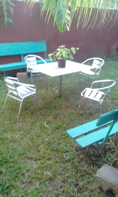 Front garden with  benches and chairs