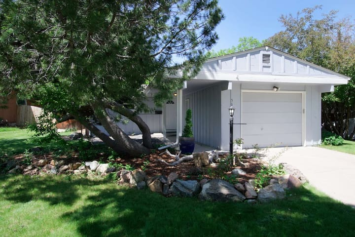 """""""The Chestnut Cozy"""" is a charming home, nestled in the quiet neighborhood of Columbine Hills in Littleton."""