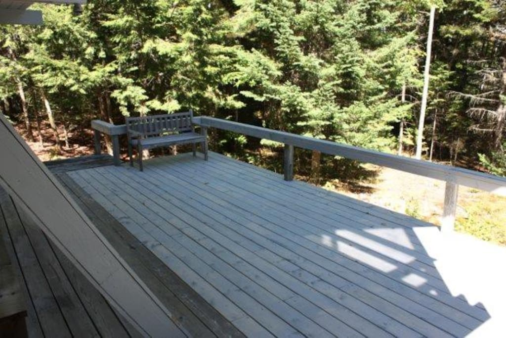 New deck family built fall 2015.  Have fun in the sun all day.  Cabin and deck are facing east.