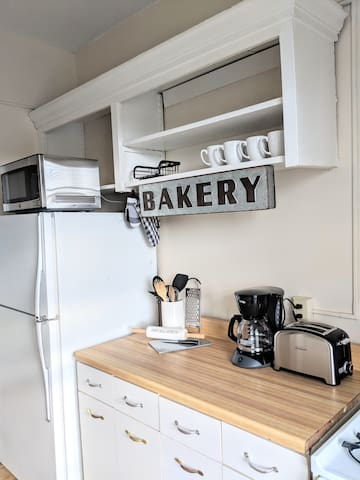 Galley Kitchen stocked with a microwave, oven, fridge, toaster, and coffee maker!