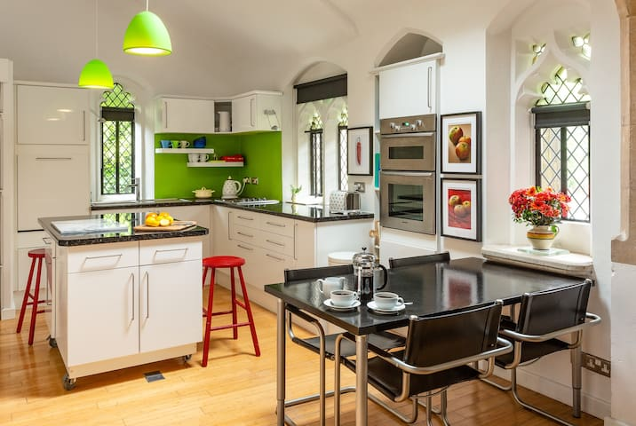 Bright, well-equipped kitchen and dining area