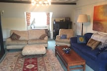 Large adjacent sitting room included in price