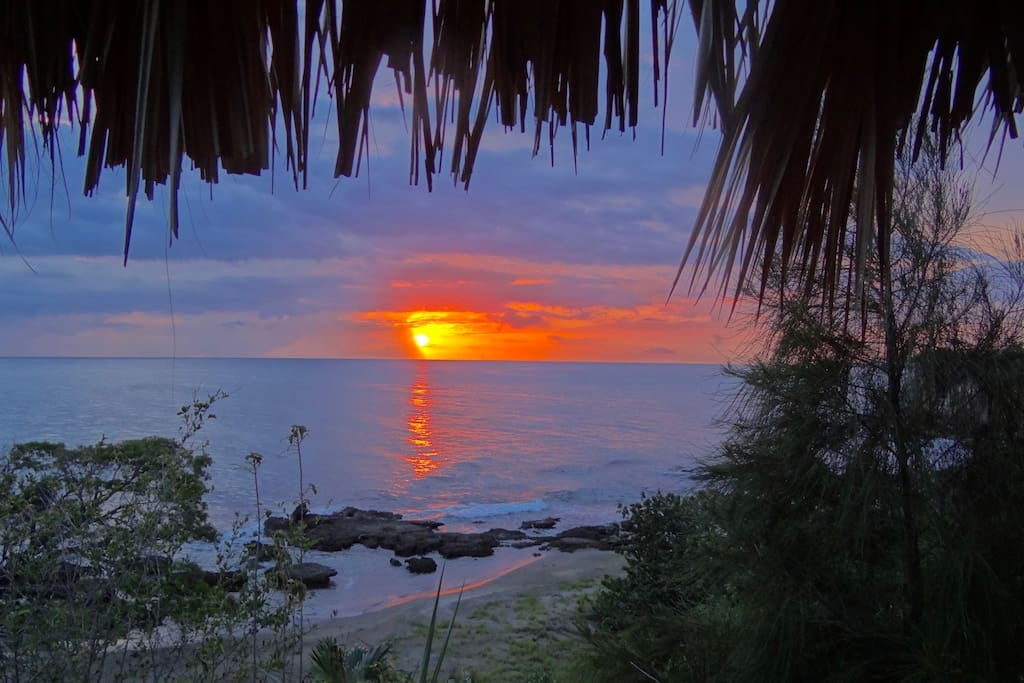 Sunset from your cabana on the cliff's edge 200 feet from the cottage
