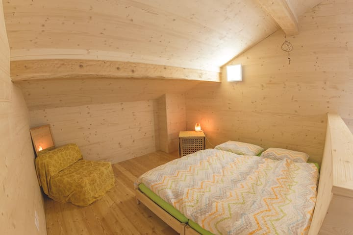 open space sleeping corner. The double bed can be separate in two single beds.