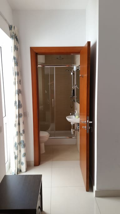 Private room with key, bathroom (shower, sink, toilet), and balcony. Free wi-fi in the room.