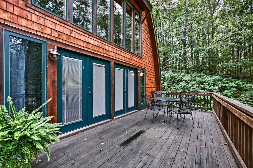 This beautiful barn-style home sits on 1.5 acres of secluded woodlands under towering birch trees.