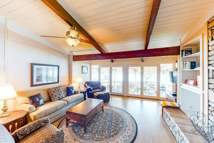 Riverfront home with private hot tub and lake views - dogs welcome!