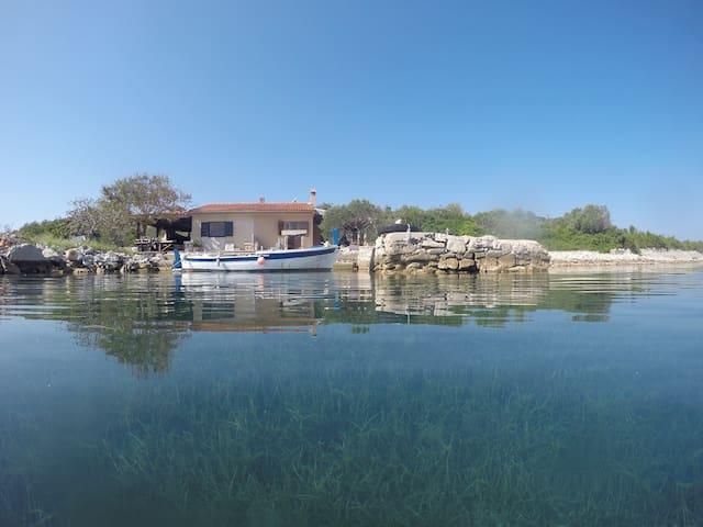 Fishing house island Iž