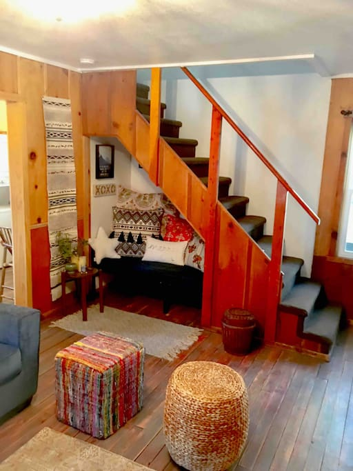 Fully renovated & decorated bohemian living room with newly refinished vintage hardwood floors from 1946.