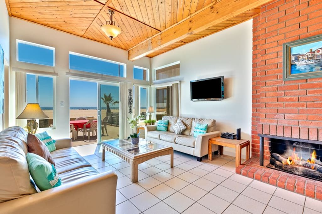 Enjoy plenty of seating in the living room with 2 couches and a seamless opening to the beach front patio