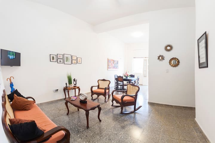 Spacious and luminous space with very high ceiling. Stylish deco with colonial furniture