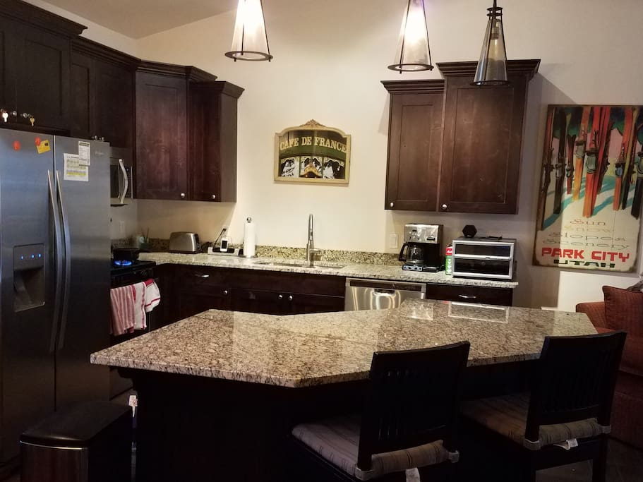 Kitchen with large island and bar stools
