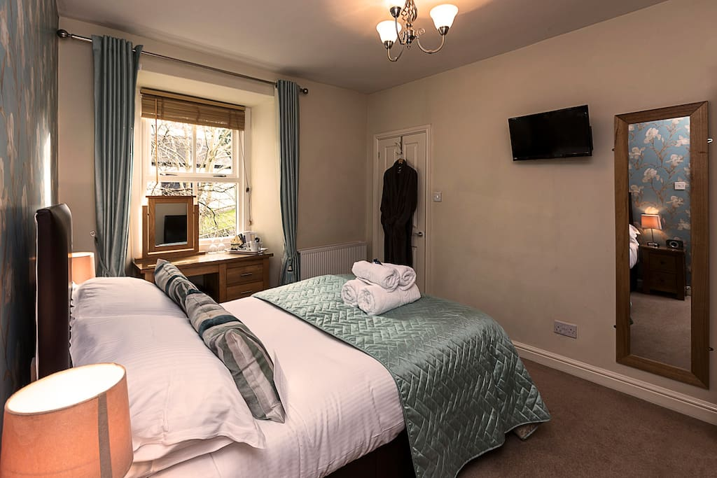 Ensuite through the door in the bedroom with the complimentary bathrobes hanging