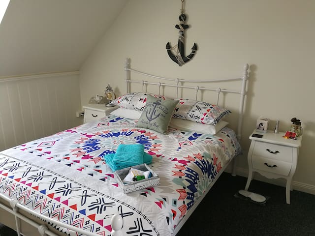 Queen Size Bed with side drawers and additional clothes storage
