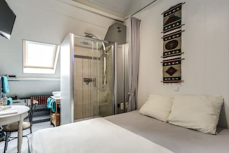 king size bed and shower