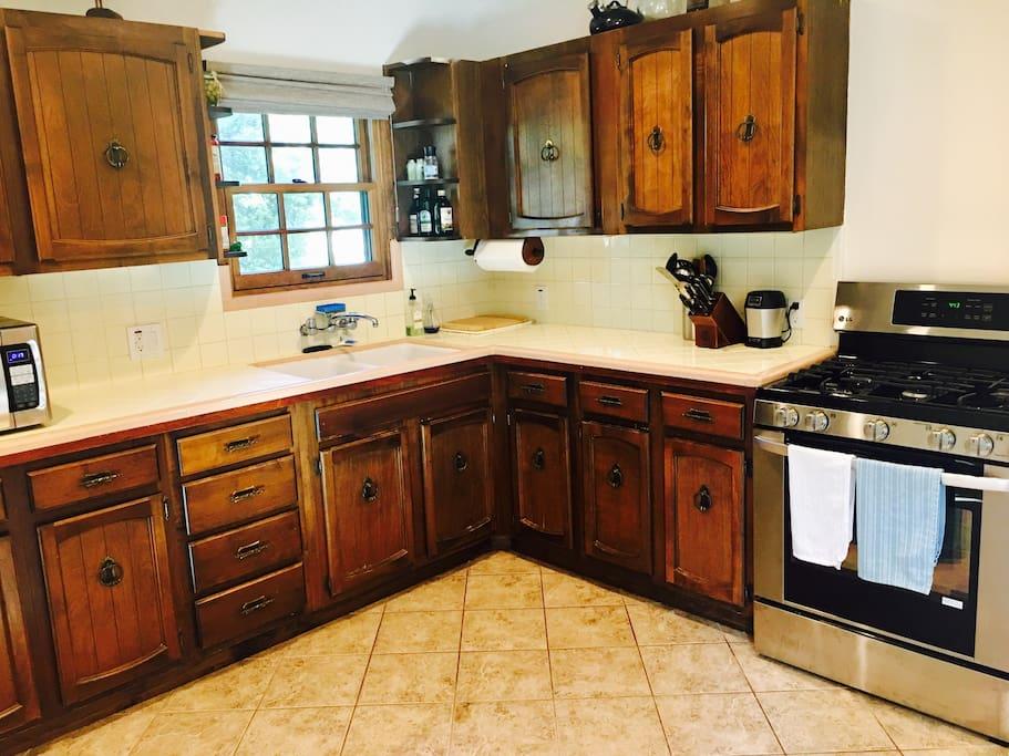 Kitchen with LG stove, microwave, toaster, Keurig, Ninja blender