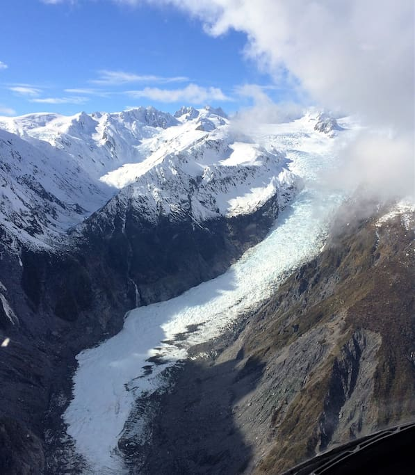 A private charter flight - Franz Josef Glacier from the air looking up to the neve basin.
