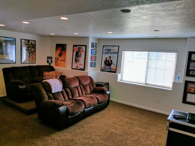 Theater seating, microfiber recliners with mini-fridge stocked with beverages.