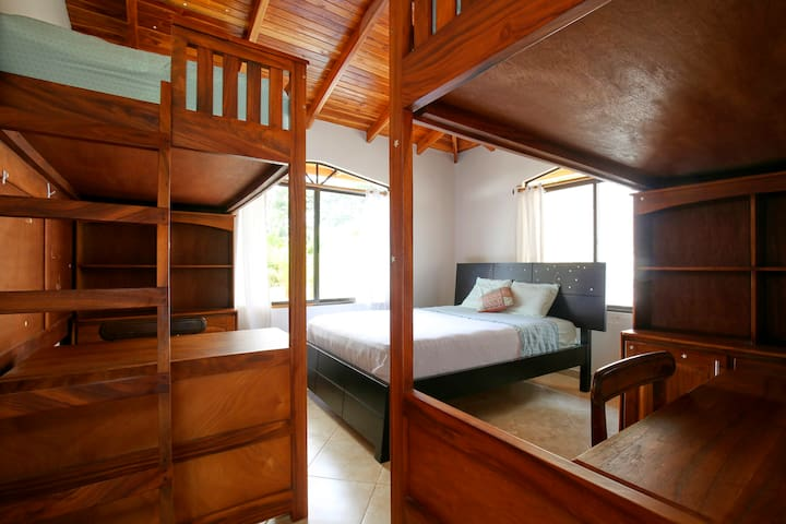 2nd bedroom, with 2 twin bunk beds and 1 queen bed