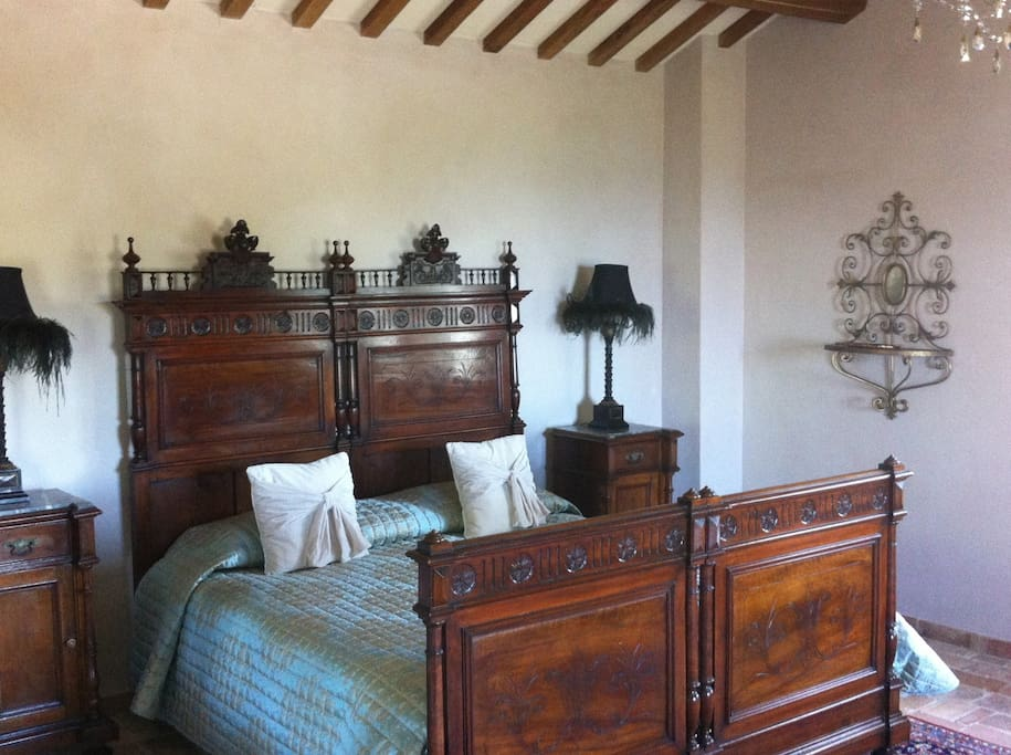 Bedroom on second floor. This bedroom has its own patio overlooking pool, vineyard and Adriatic.