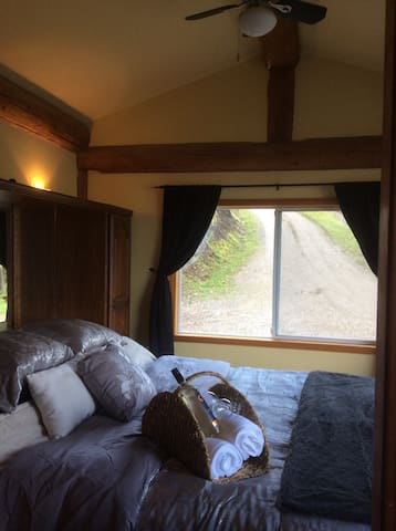 Master suite with vaulted ceilings and king-size bed. Relax with a bottle of wine and head to the hot tub!