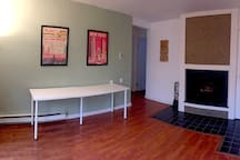 Lower level family/living room with fireplace.