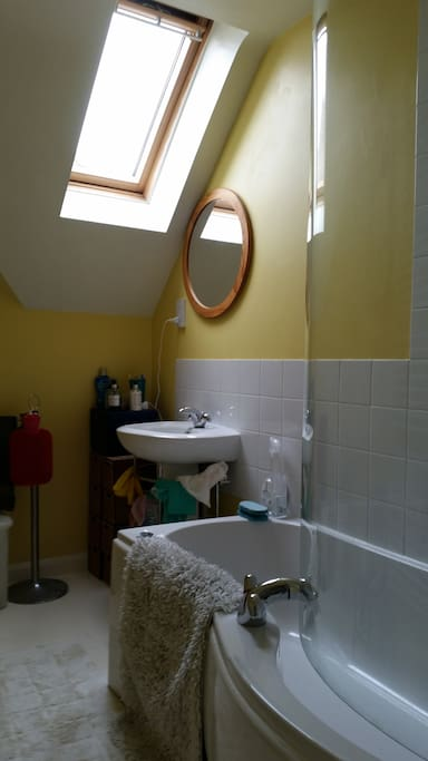 Bathroom showing window, sink, mirror,  power point.