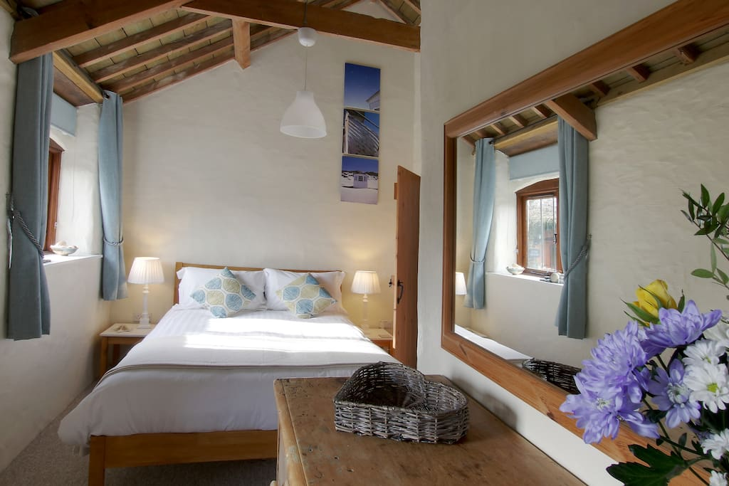 The main bedroom has a king-size bed & en-suite shower room