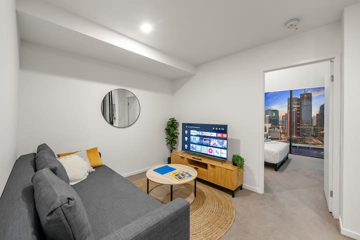 My comfy air-conditioned living room. That is a 4K Smart TV with Netflix capabilities. You will be able to watch practically anything.  I have tried to make the whole apartment as homely and comfortable for you as possible.