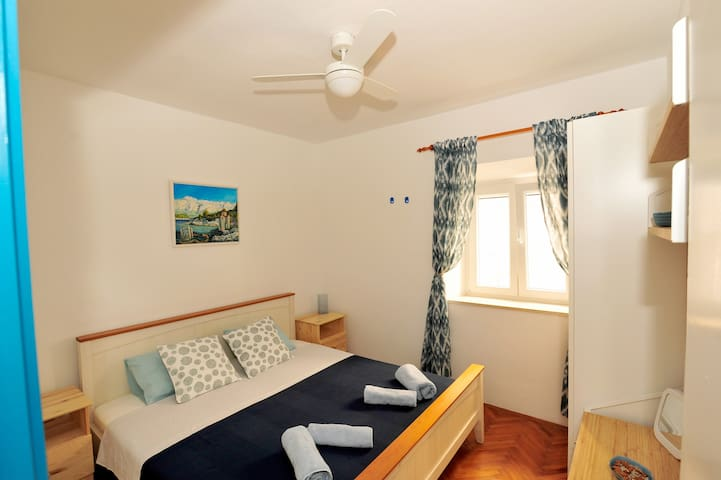 Room includes air condition, celling fen, mosquite nets, cabinet and towels for your use.