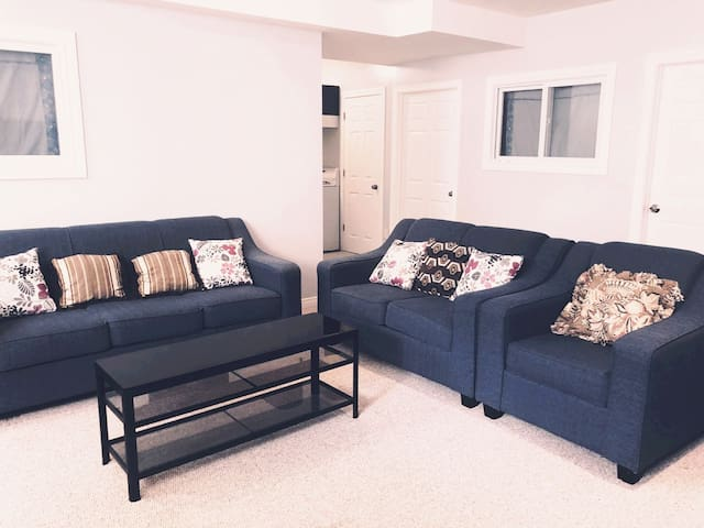Spacious living room with 2 sofas and one sofa chair