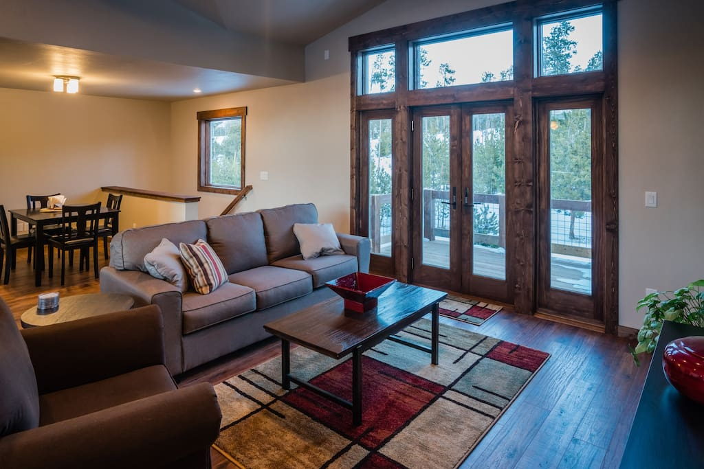 Living room with doors out onto back deck