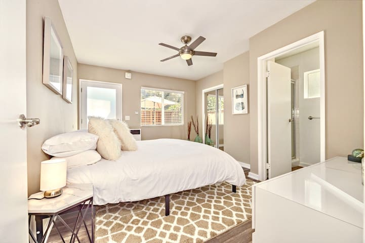 Bedroom #1 with King Bed and attached Private Bathroom with Shower. This Bedroom opens to your Gorgeous and Sunny Patio with lounge furniture and BBQ, for the use of this unit only
