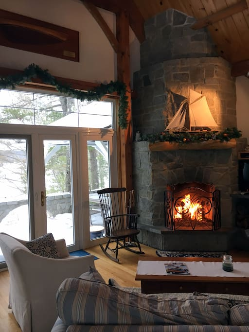 Fireplace with snow covered patio