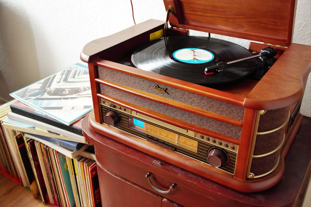 a record player together with vinyl collection,