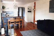 Dining table for 4 to 6 people. Beyond the breakfast bar is your kitchen with full sized oven and fridge, microwave, & dishwasher