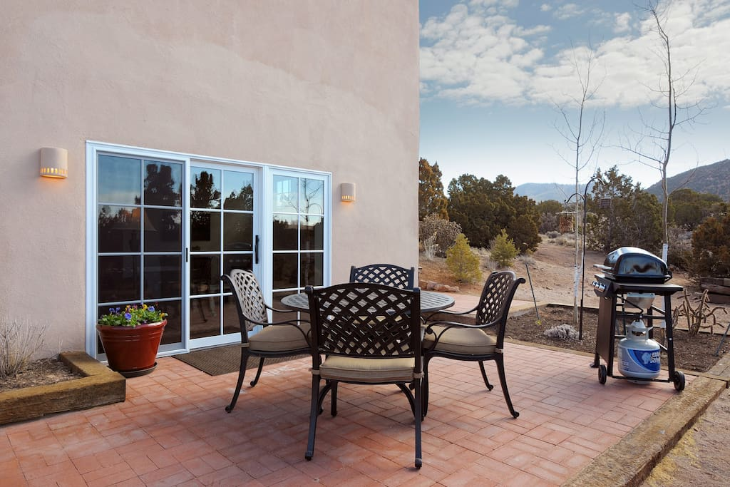 Large patio with grill and views.