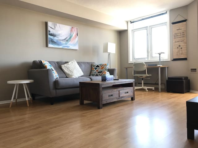 Livingroom. Refreshed decor with a beautiful view of the Ottawa river!