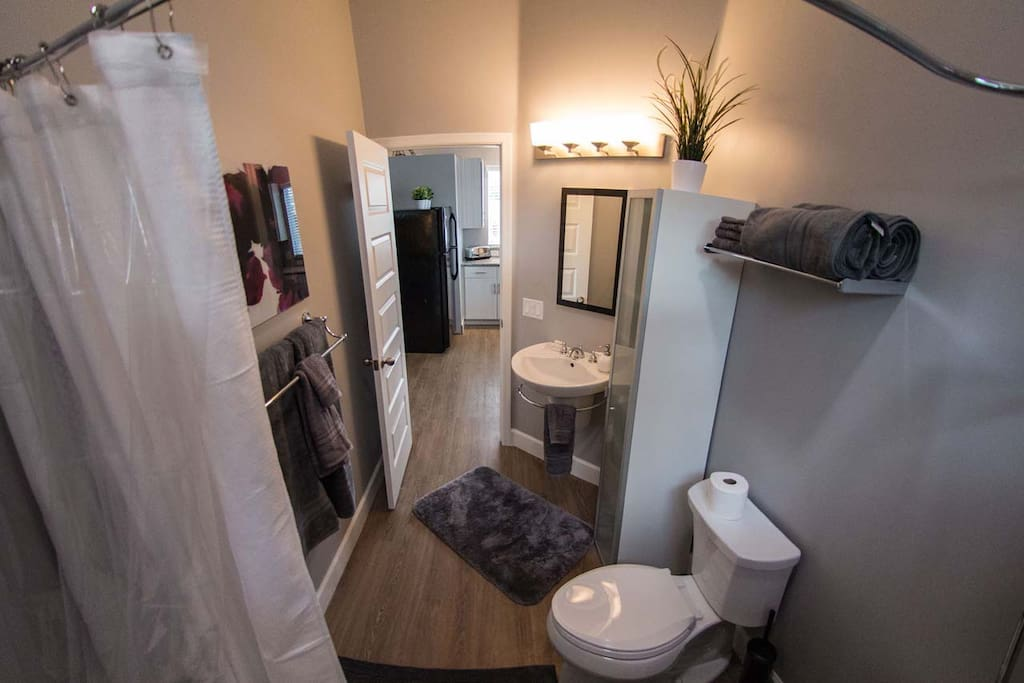 Full bathroom with soaking tub and shower.