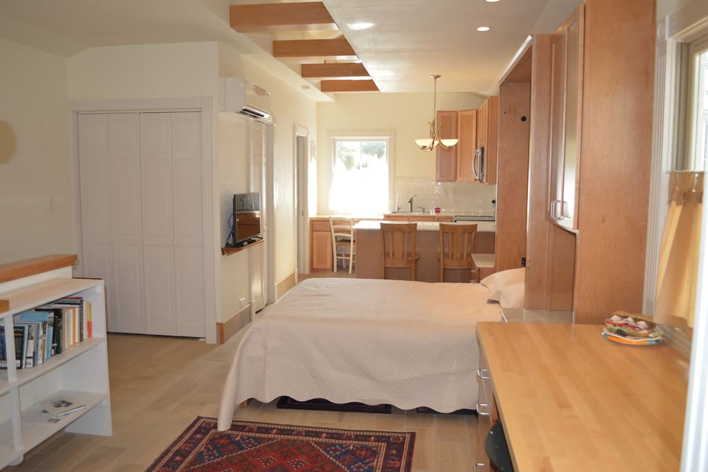 View of bed/kitchen from desk area.