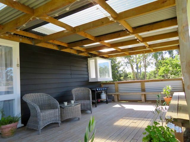 Large sheltered deck with seating and BBQ enjoy the sun or the stars.