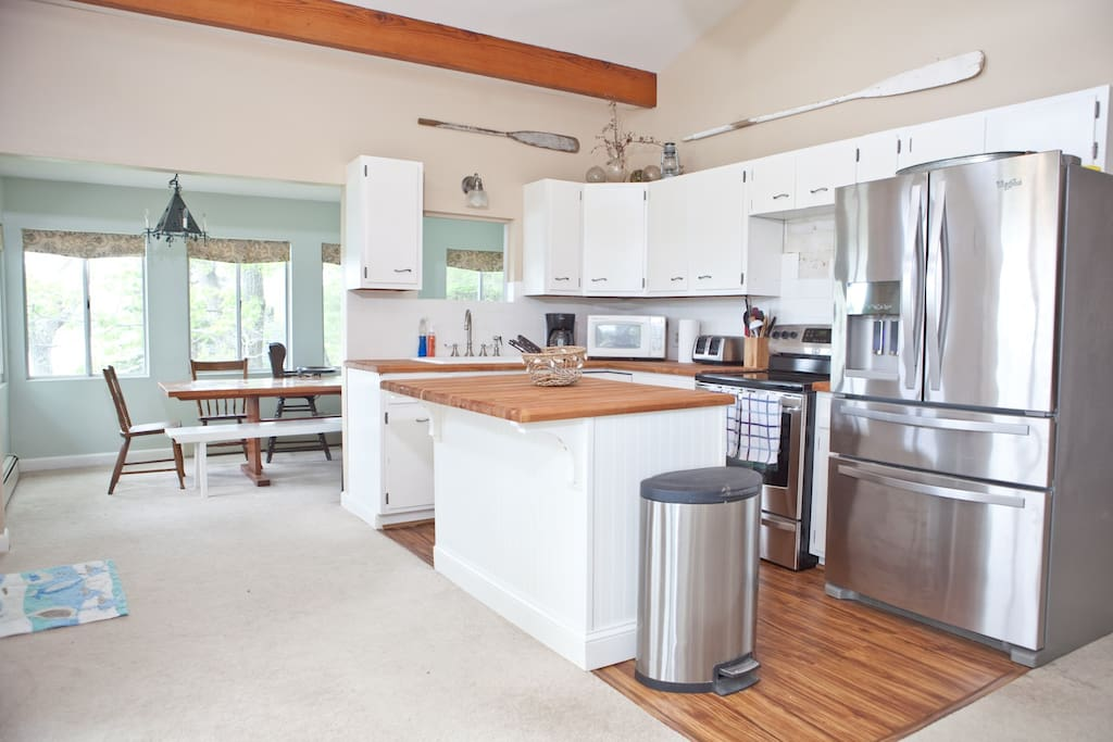 Newly renovated kitchen has oversized stainless steel refrigerator, dishwasher, electric stove and oven. Kitchen is fully stocked with all the utensils/cookware you need.