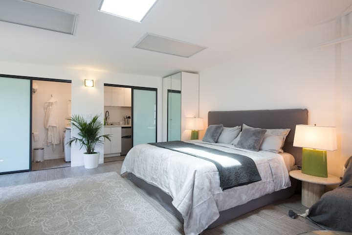 Relax on the king size bed with its memory foam mattress