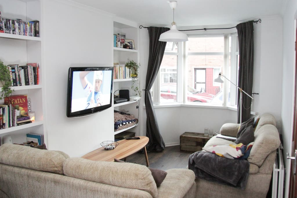 Living room with entertainment facilities. Books and DVDs available to borrow during stay.  PlayStation, Amazon Prime, Netflix and Virgin Media TV available.