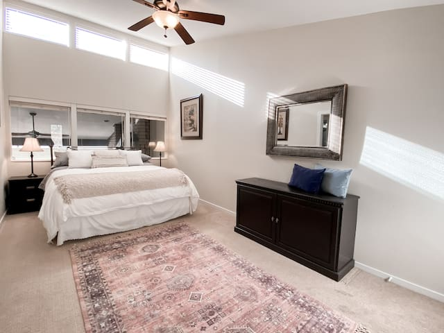 A large bedroom with a King bed and Murphy Cabinet that opens up to a full-bed.
