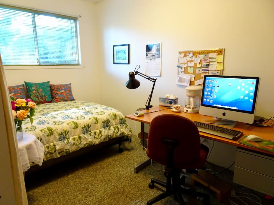 This small guest room has a coffee maker, desk, and a door you can lock from the inside
