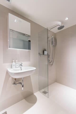 Bathroom comes equipped with European rain shower for a spa-like experience! (Room Design #1)