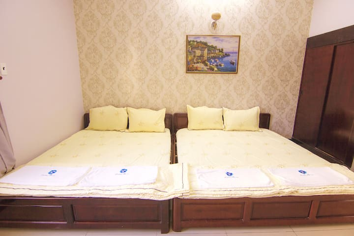 Bedroom 103 with two comfortable double beds for great night's sleep