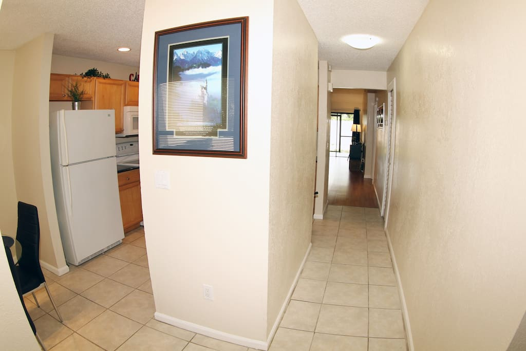 walking in - to the left are 2 bedrooms and to the right is the kitchen and breakfast nook