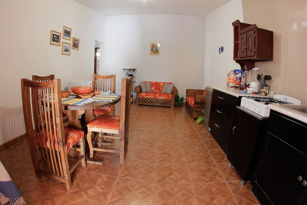 A small dinning room and a fully furnished kitchen offers a space for family during breakfast or lunch!